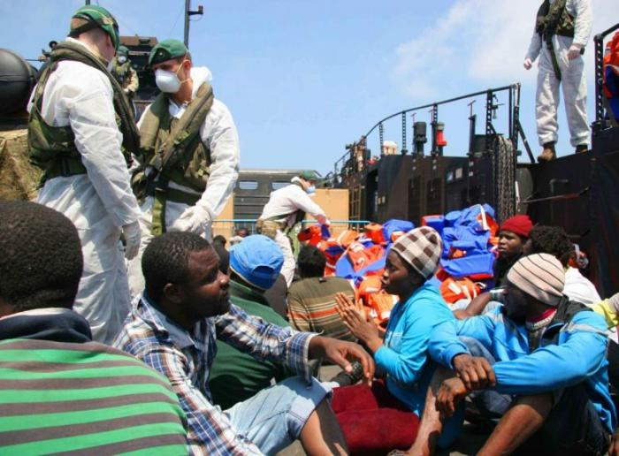 Migrants are rescued by crew from HMS Bulwark of the Royal Navy in the Mediterranean